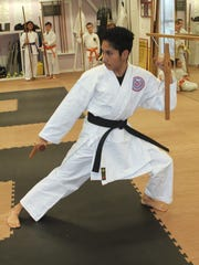 Bryant Martinez is seen in action at the Shima Dojo Karate School at the Marco Y.