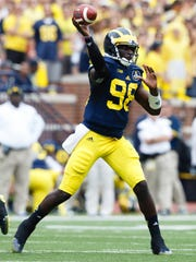 Michigan quarterback Devin Gardner (98) passes the ball during the second quarter against Appalachian State at Michigan Stadium. He completed 13 of 14 attempts for 173 yards.