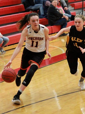 Viola's Sami McCandlis dribbles past Salem's Chelsea Hamilton on Wednesday night in the district final at Flippin.