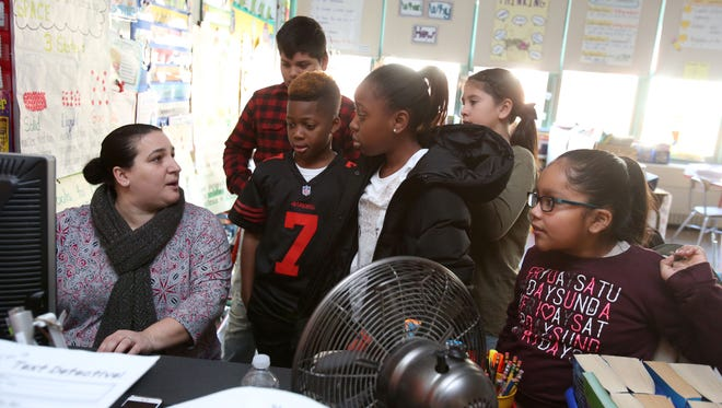 Fourth-grade teacher Leandra Fulgione talks to students at Alice E. Grady Elementary School in Elmsford in November.