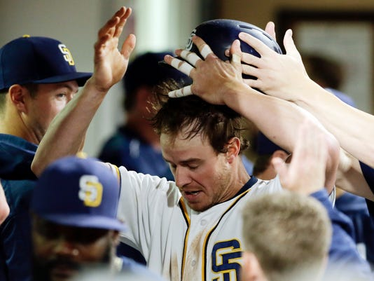 Teammates pull the helmet off of the San Diego Padres' Wil Myers in the dugout after his home run hit during the fifth inning of a baseball game against the Washington Nationals, Thursday, June 16, 2016, in San Diego. (AP Photo/Gregory Bull)
