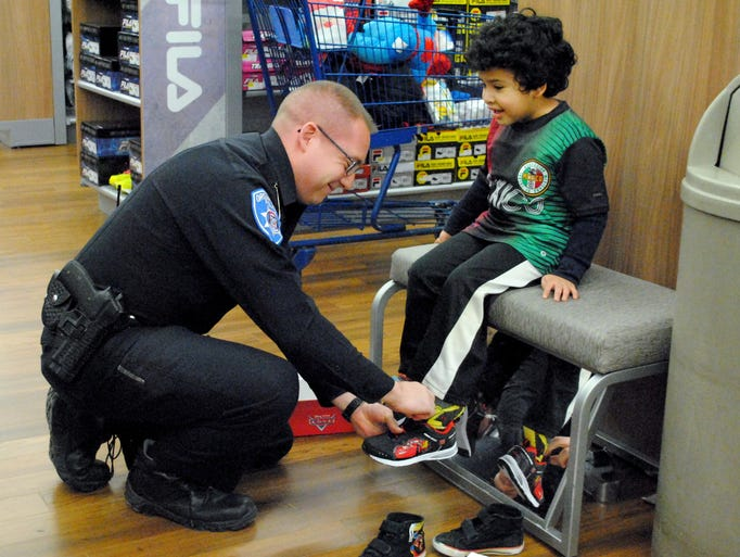 Orchard Lake Police Officer Jeff Gomez helps Jencho