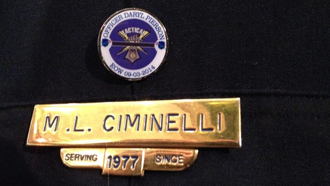 The pin on RPD Chief Michael Ciminelli.