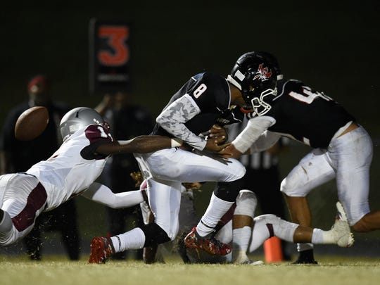Pearl-Cohn's Xavier Shepard, #8,  strips the ball from Maplewood's Makell Smith,  #14, on Friday, September 30, 2016.