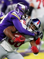 New York Giants wide receiver Victor Cruz is tackled