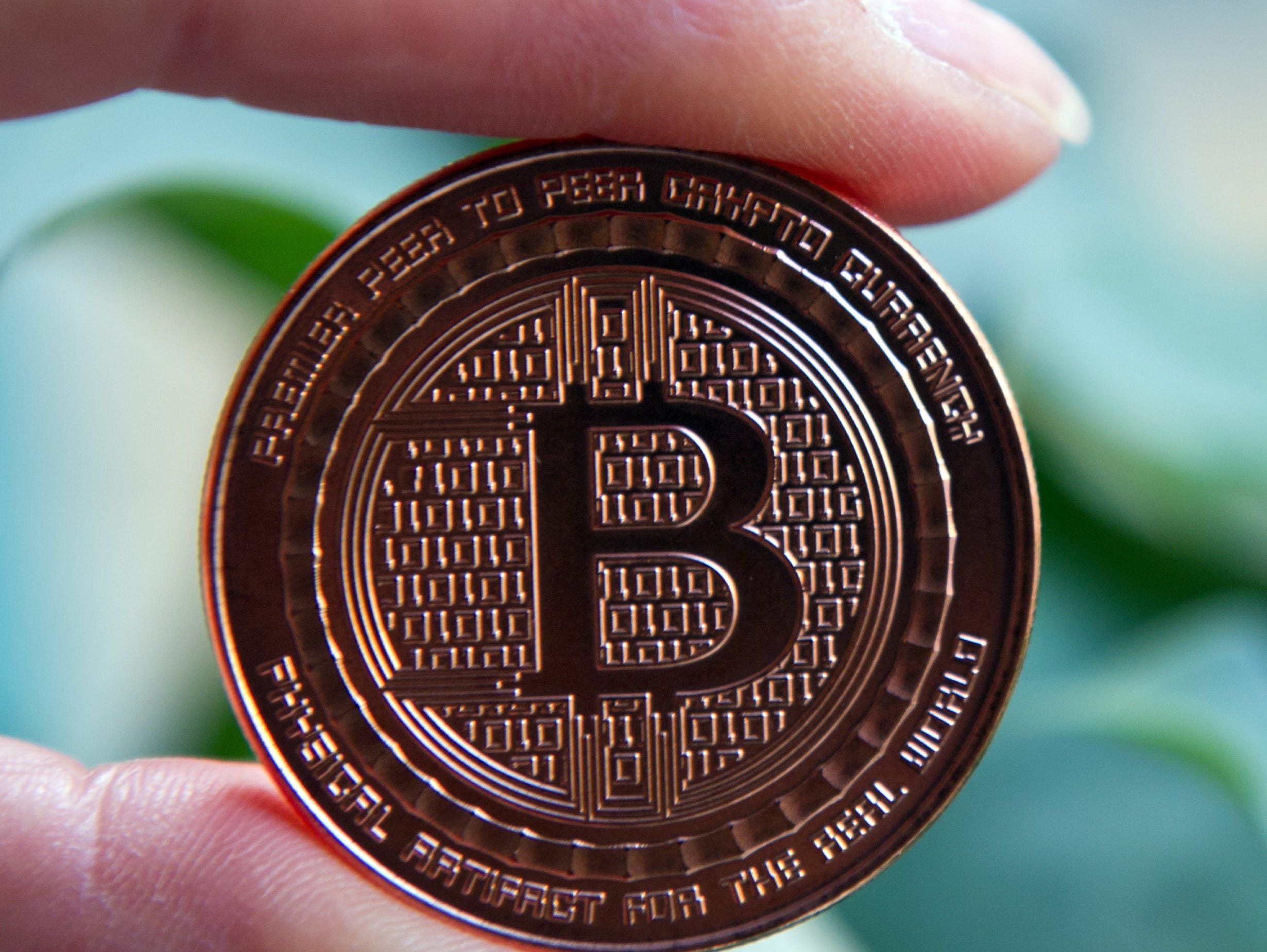 This May 1, 2014 photo taken in Washington, DC shows a bitcoin medal. Bitcoin uses peer-to-peer technology to operate with no central authority or banks; managing transactions and the issuing of bitcoins is carried out collectively by the network. Th