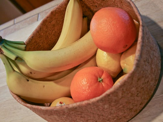 The cork fabric bowl is soft and durable and it conforms to the shape of what's placed inside it. It's great for easy-to-bruise fruit and vegetables.