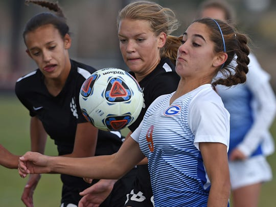 Galena's Raquel Johnson, left, and Mary Snelgrove looks to challenge Bishop Gorman's Jaden Terrana for the ball in a semifinal game in the Nevada State Championship.