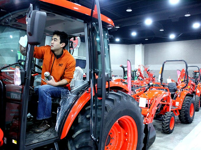 Travis Oh is seen cleaning a Kioti tractor in preparation for the National Farm Machinery Show and Championship Tractor Pull at the Kentucky Exposition Center. February 10, 2014