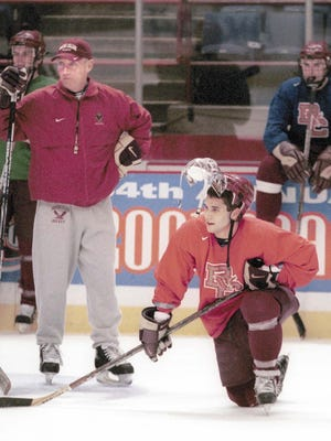 Boston College coach Jerry York and forward Brian Gionta, right, watch their team prepare for the NCAA Frozen Four at the Pepsi Arena, in Albany, N.Y., Wednesday, April 4, 2001. Gionta helped BC win the NCAA title and has returned to Boston with Bruins.