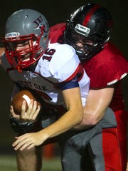 Liberty's Lucas Bates (72) sacks West Oak's Jackson Davis (16) during the first half of the game on Friday, September 22, 2017 at Liberty High in Liberty.