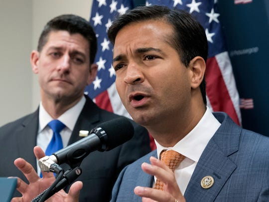 Rep. Carlos Curbelo, R-Fla., right, stands with Speaker of the House Paul Ryan, R-Wis., left, discussing the GOP agenda for tax reform during a news conference on Capitol Hill in October.