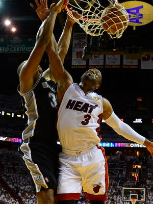 Spurs forward Boris Diaw dunks on Heat guard Dwyane Wade in Game 4 of the NBA Finals.