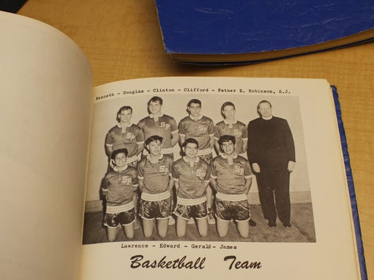 Father Edmund Robinson also served as the basketball coach at St. Paul's Mission School in Hays, Montana.