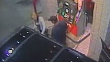 Surveillance video at a Fry's gas station in Phoenix on Jan. 22, 2016 shows a man wearing a baseball cap pumping gas and a woman assisting him. The purchase could have been made with a stolen credit card.