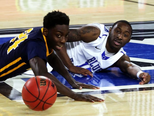 The ball gets away from MTSU's JaQuel Richmond, right,