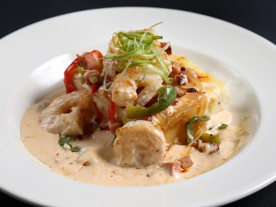 Shrimp and grits, with white corn and cheddar grits