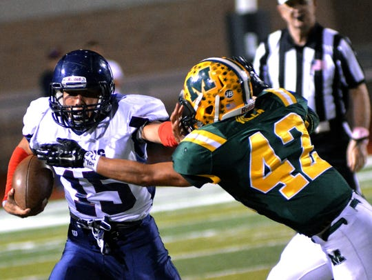 mayfield linebacker Michael Villa tries to stop Deming