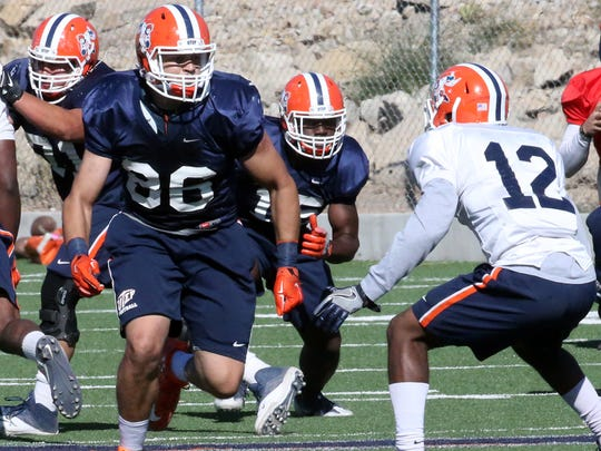UTEP transfer tight end Josh Weeks, 86, runs plays Monday during spring practice at Glory Field.