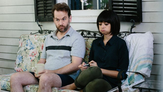 "Mike Birbiglia, left, and Kate Micucci appear in a scene from, ""Don't Think Twice."""