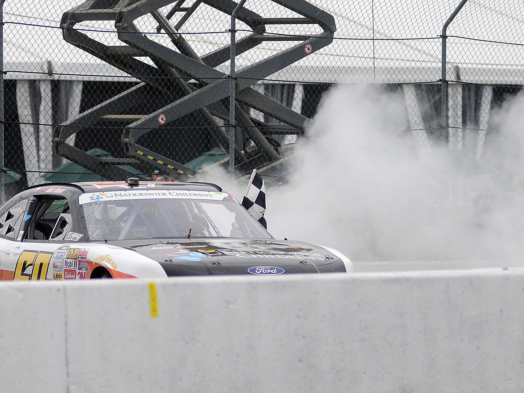 Chris Buescher burns rubber after winning the second Nationwide Children's Hospital 200 last year at the Mid-Ohio Sports Car Course. Buescher, who leads the NASCAR Xfinity Series points standings, will be back for the race Aug. 15 to defend his win.