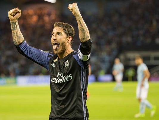 Real Madrid's Sergio Ramos gestures during a Spanish La Liga soccer match between Celta and Real Madrid at the Balaidos stadium in Vigo, Spain, Wednesday, May 17, 2017. (AP Photo/Lalo R. Villar)