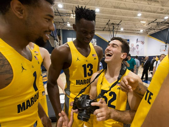 Ike Eke (center) jokes around with Marquette teammates Ed Morrow (left) and Cam Marotta during the the team's media day in 2017.
