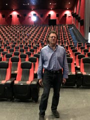 Peter Edelmann stands in the T-Rex Theater in Essex on Wednesday, April 18, 2018.
