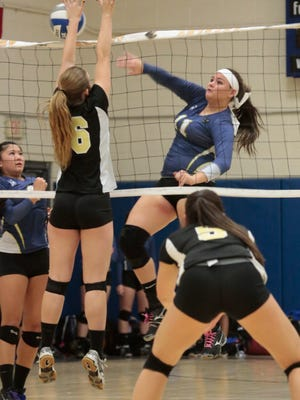 Nanuet's Megan Cain (16) jumps to block Ardsley's Nicolina Chenard (11) during the Section 1 Class B quarterfinal volleyball at Ardsley High School on Nov. 3, 2015.