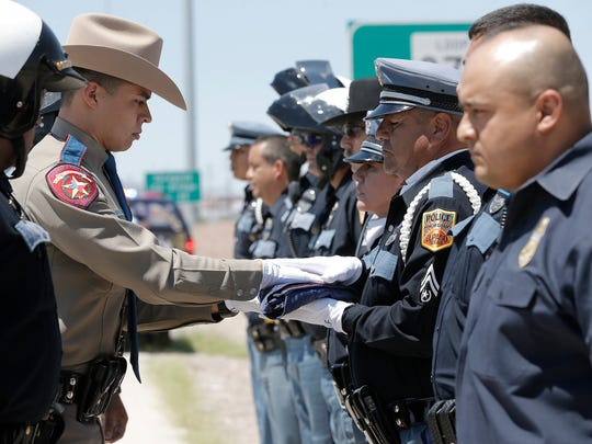 El Paso Police Officer Miguel Contreras receives the