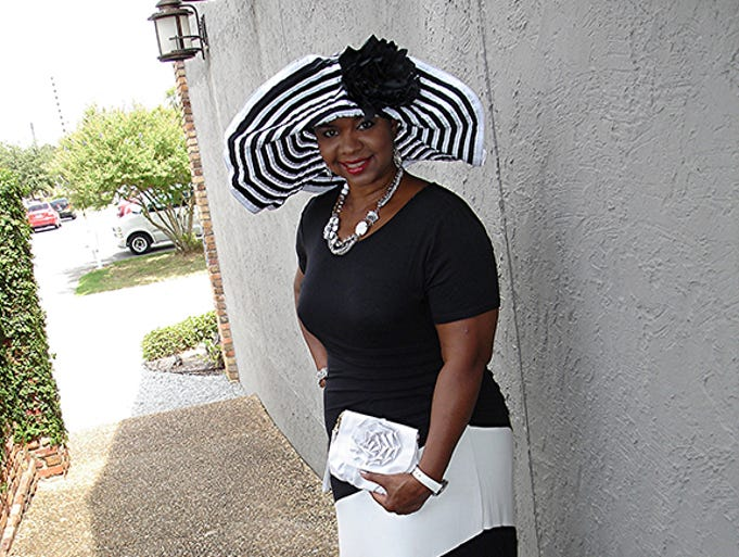 Angelique Morris  Branch manager at Central Credit Union of Florida. Her style: I'm classy and chic in style. I like long dresses ... all long, no short ones. And I like a short sleeve. Black and white are my favorite colors. I love hats and have  a collection of about 20. I prefer sandals and little handbags. And oh yes, I like jewelry. I like to match my accessories.<br /> Favorite shops: Belk and Stein Mart.<br /> For this story and more stories and photos, see the September issue of Pensacola Bella Magazine, and go to www.BellaMagazine.com.