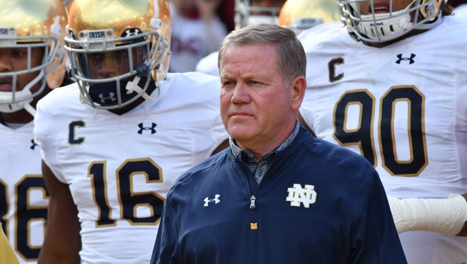 Nov 26, 2016; Los Angeles, CA, USA; Notre Dame Fighting Irish head coach Brian Kelly leads his players onto the field for the game against the USC Trojans at the Los Angeles Memorial Coliseum. Mandatory Credit: Matt Cashore-USA TODAY Sports