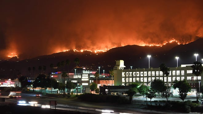 The La Tuna Canyon fire burns in the hills above Burbank, Calif., early Sept. 2, 2017. 