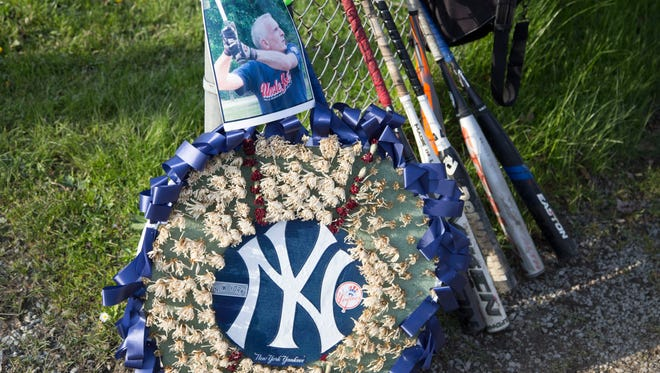 A small memorial behind the backstop of the Cass Park ballfields remembering Jeff Rosenberg, who died earlier this year.