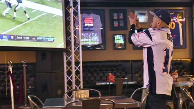 Patriots fan Jimmy Ronquillo cheers on his team during  Super Bowl LII.
