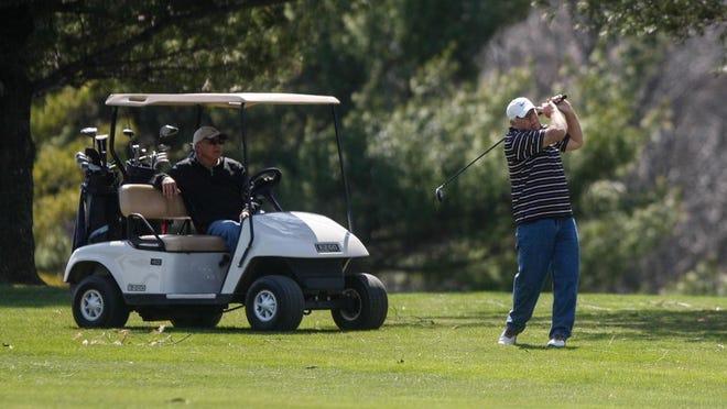 Golfer Rick Mirton drives a ball down the fairway.  Golfers hit the links at Pleasant Run Golf Course, April, 10, 2014.