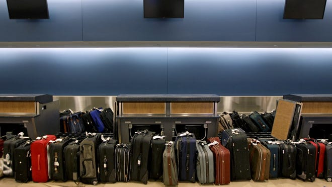 Luggage waits to be run through the baggage system for testing ON March 28, 2012, at Atlanta's airport.