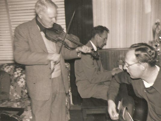 Elmer Carter playing fiddle with family fr Jay Robersobn