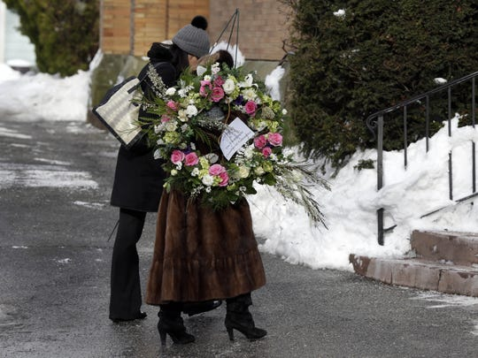 A flower arrangement arrives for the funeral of Ellen Brody on Friday at Chabad of the Rivertowns in Dobbs Ferry. Brody, 49 and a mother of three, was killed along with five rail passengers on Tuesday night, when a Metro-North commuter train crashed into her vehicle on the tracks at a railroad crossing in Valhalla.