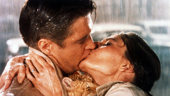 """George Peppard (left) and Audrey Hepburn are shown in a scene from """"Breakfast at Tiffany's."""""""