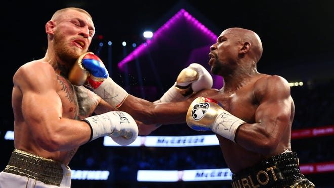 Aug 26, 2017: Floyd Mayweather Jr. lands a hit against Conor McGregor during a boxing match at T-Mobile Arena.
