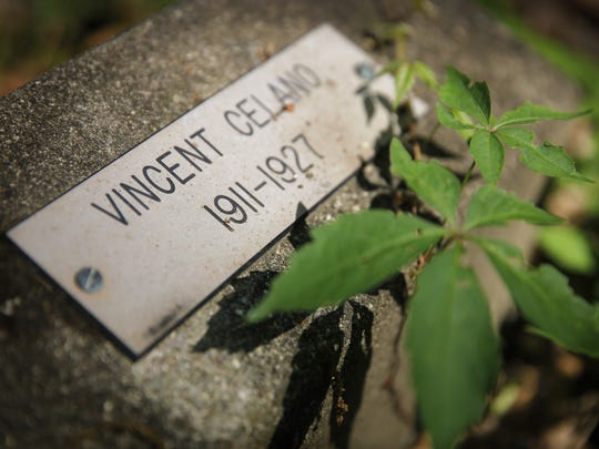 The grave of Vincent Celano, one of 14 boys buried in the graveyard. Celano drowned while trying the escape the school in 1927.