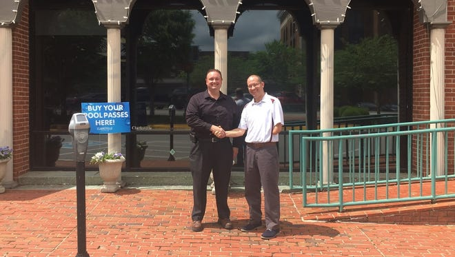 Clarksville Parks and Recreation Deputy Director Dan Carpenter, right, thanks Dennis Potvin for donating money to provide free recreation center memberships to veterans and their families.