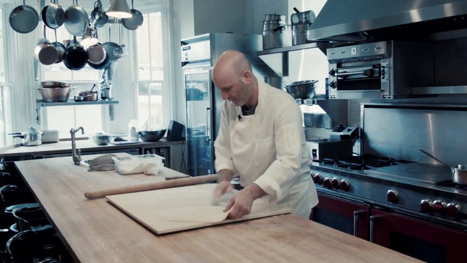 Marc Vetri works on a sheet of pasta dough in a kitchen of one of his restaurants. He calls his new pasta cookbook his life's work.