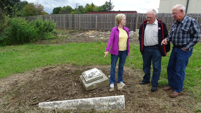 Washington Township Trustees Kay Leitenberger, Bob Entenmann and Jack Butler discuss an obelisk in the old Swisher cemetery, where they will soon rededicate two veteran's graves with new markers.