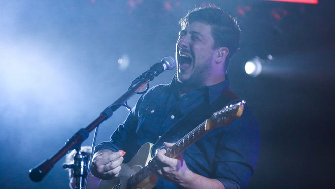Mumford & Sons performs for the crowd on Tuesday at DTE Energy Music Theatre in Clarkston.