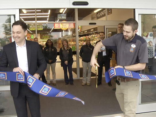 A ribbon-cutting ceremony marks the opening of Aldi's