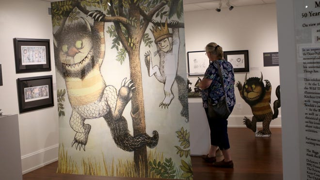 "A visitor to the Biggs Museum of American Art explores author and illustrator Maurice Sendak's work from his famed children's book ""Where the Wild Things Are,"" which is being celebrated in a 50th anniversary memorial exhibition."