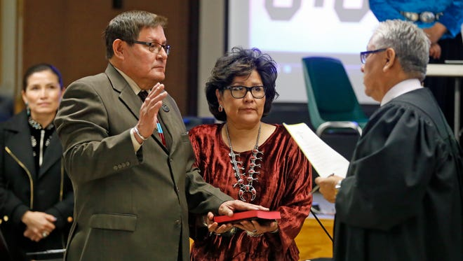 LoRenzo Bates, left, takes the oath of office for speaker of the Navajo Nation Council during the winter session on Monday in Window Rock, Ariz. Acting Chief Justice Allen Sloan, right, administered the oath.