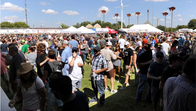 Visitors mingle during the 4th Abilene Beer Summit last year. Nearly 50 breweries offered about 140 different beers to sample at the Frontier Texas! parade ground.